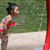 Roger Schneider | The Goshen News<br /> As the temperature reached into the high 80s Wednesday, Evelyn Lara, 2, of Goshen, decided to take a sip of the water at the Rieth Park splash pad. The park department's splash pads have been popular this week as tempetures moved into the 90s and high 80s. The National Weather Service forecast is for continued daily highs of 90 or above for the rest of the week.