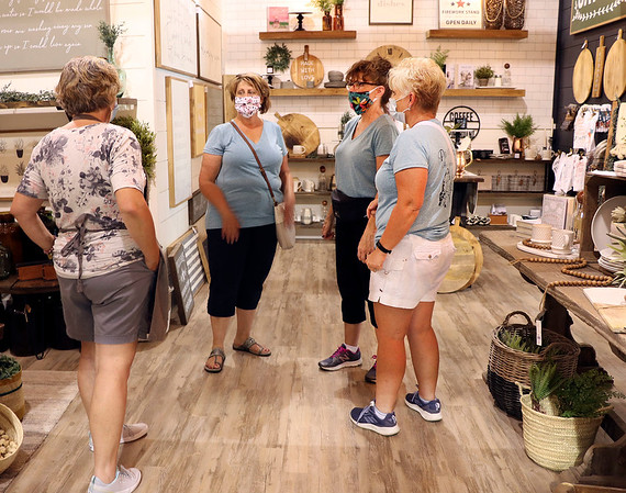 Linda Gorsuch, left, an employee of Joyfully Said in Middlebury, talks with a group of ladies who were visiting from Port Huron, Michigan, Tuesday. The visitors, from left, are Brenda Stoliker, Pam Anecki and Julia Frantz.