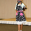 John Kline   The Goshen News<br /> Renee Welling, 10, of Goshen, shows off her hand-crafted panda ensemble during the Elkhart County 4-H Fashion Revue Friday morning at the Elkhart County 4-H Fairgrounds.