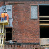 Roger Schneider   The Goshen News<br /> Two men working on the InSite Development project that is renovating the north end of the historic Hawks building in Goshen, check out the west wall of the building Wednesday afternoon.