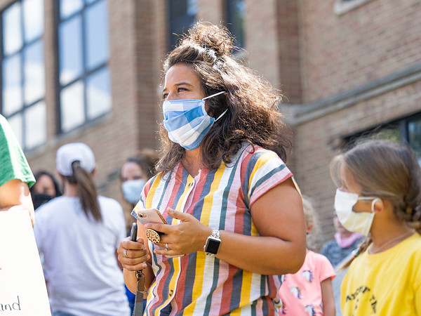 Jessica Graber, of Middlebury, speaks during an interview during the protest Friday at the Elkhart County Health Department in Elkhart.