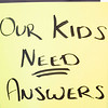 "A ""Our kids need answers"" sign is held up during the protest Friday at the Elkhart County Health Department in Elkhart."