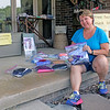 Roger Schneider   The Goshen News<br /> Kris Peterson sits on her front porch. She provides kits for sewing masks and also accepts finished masks that will be distributed to local schools.