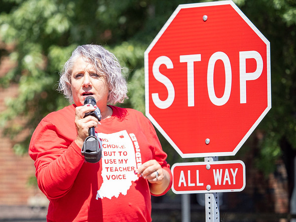 Christy Fisher, of Goshen, speaks to the crowd during the protest Friday at the Elkhart County Health Department in Elkhart.