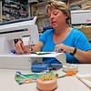 Roger Schneider   The Goshen News<br /> Kris Peterson sews a face mask in her craft room.