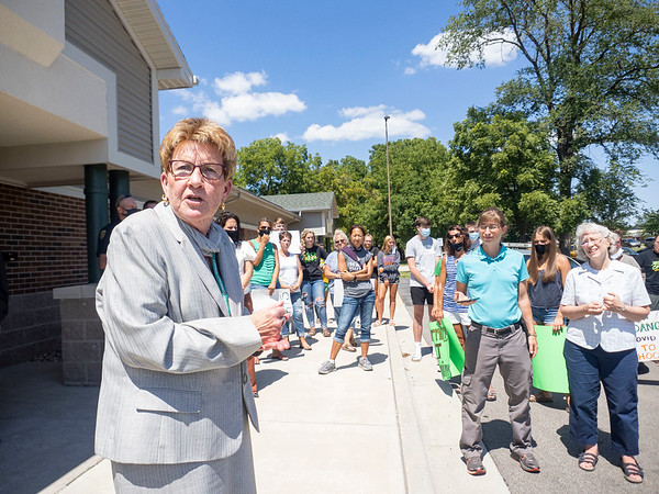 Middlebury Community Schools Superintendent Jane Allen, left, speaks to the public during the protest Friday at the Middlebury Community School Administration Building in Middlebury.