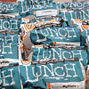 Roger Schneider   The Goshen News A collection of lunch bags containing non-perishable food items and plastic utensils are ready to be distributed to Goshen parks as part of the summer lunch program operated by Goshen Community Schools. Some Goshen students will received bagged breakfasts when they return to school in August.