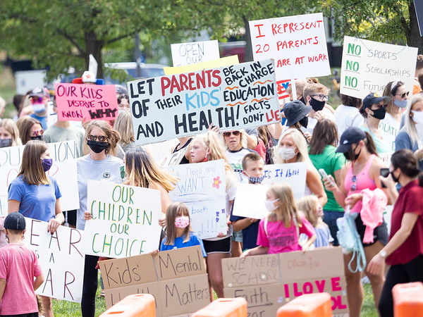 Both parents, teachers, and students assemble Friday at the Elkhart County Health Department in Elkhart.