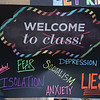 """""""Welcome to class control, fear, socialism, depression, isolation, anxiety, and lies"""" sign during the protest Friday at the Elkhart County Health Department in Elkhart."""