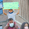 Joel Graber holds his son Juriah Graber, 5, both of Middlebury, on his shoulders during the protest Friday at the Elkhart County Health Department in Elkhart.