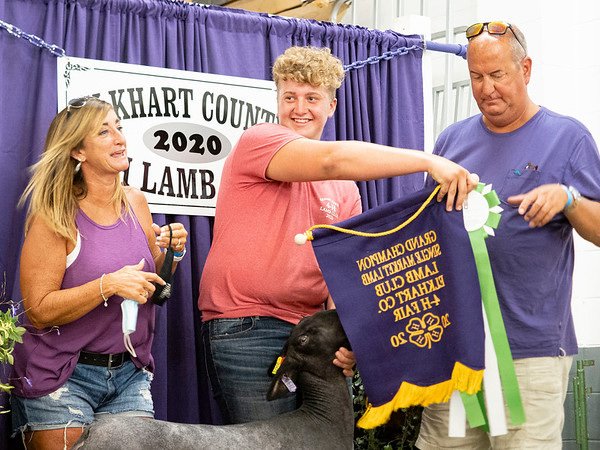 Chase Graber, 16, of Goshen, center, reacts after being crowned overall Grand Champion Lamb Tuesday during the 2020 4-H Showcase at the Elkhart County 4-H Fairgrounds in Goshen.