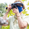 Jill Fowner, of Osceola, takes a photograph during the weekly Summer bird walk Wednesday afternoon at Wellfield Botanic Gardens in Elkhart. The weekly bird walks are held every Wednesday at 4:00 p.m. from July first through September 30.