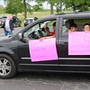John Kline | The Goshen News<br /> Parkside Elementary School students hold up signs thanking their teachers during a special end-of-year drive-in celebration at Harvest Community Church Monday evening.