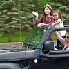 John Kline | The Goshen News<br /> Parkside Elementary School students wave to their teachers during a special end-of-year drive-in celebration at Harvest Community Church Monday evening.