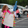 John Kline | The Goshen News<br /> Heather Steffen, a fourth grade teacher at Parkside Elementary School, waves to passing students during a special end-of-year drive-in celebration at Harvest Community Church in Goshen Monday evening.