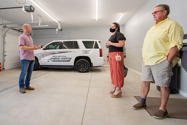 Town of Walkarusa Town Council Matt Moyer, left, showcases the new Wakarusa Police Station garage Thursday afternoon to Greater Elkhart Chamber of Commerce Event and Marketing Coordinator Carolina Pagan and Union Township Trustee Kenneth Miller, right, during the Ribbon Cutting Ceremony at 102 Spring Street in Wakarusa.