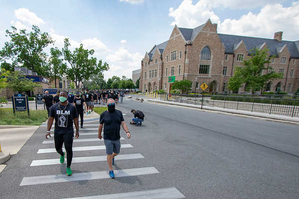 Notre Dame defensive lineman Daelin Hayes, left, and Head Coach Brian Kelly interact with each other and lead the Juneteenth celebration walk around Notre Dame Campus Friday afternoon during Notre Dame's celebration of Juneteenth with peaceful prayer and walk.