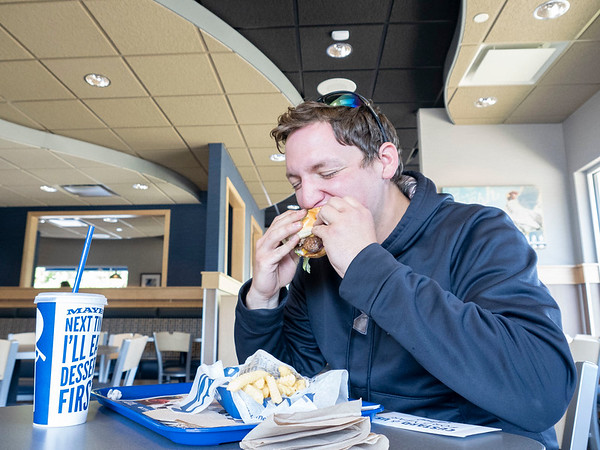 Austin Miller, of Middlebury, is the first customer to eat and dine-in Monday morning at the new Culver's on Elkhart Road in Goshen. For being the first customer at the new location Miller is one of 12 people who received a certificate for a one year supply of Culver's custard.