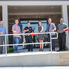 Walkarusa Town Marshal Tim Hershberger, center, cuts the ribbon Thursday afternoon at the Wakarusa Police Station during the Ribbon Cutting Ceremony at 102 Spring Street in Wakarusa.