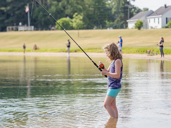 Sarah Johnson, 7, of Goshen, reels her line back in at Fidler Pond Saturday morning during the Fidler Pond's Fantastic Fishing Derby.