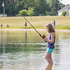 Sarah Johnson, 7, of Goshen, reels her line back in at Fidler Pond Saturday morning during the Fidler Pond's Fantastic Fishing Derby.