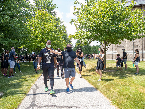 Notre Dame defensive lineman Daelin Hayes, left, and Head Coach Brian Kelly lead the Juneteenth celebration walk around Notre Dame Campus Friday afternoon during Notre Dame's celebration of Juneteenth with peaceful prayer and walk.