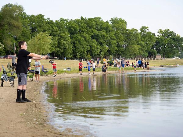 Connor Mast, 13, of Goshen, casts his line into Fidler Pond Saturday morning during the Fidler Pond's Fantastic Fishing Derby.