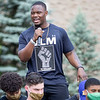 Notre Dame defensive lineman Daelin Hayes speaks to the crowd at the Irish Green on Notre Dame Campus Friday afternoon during Notre Dame's celebration of Juneteenth with peaceful prayer and walk.