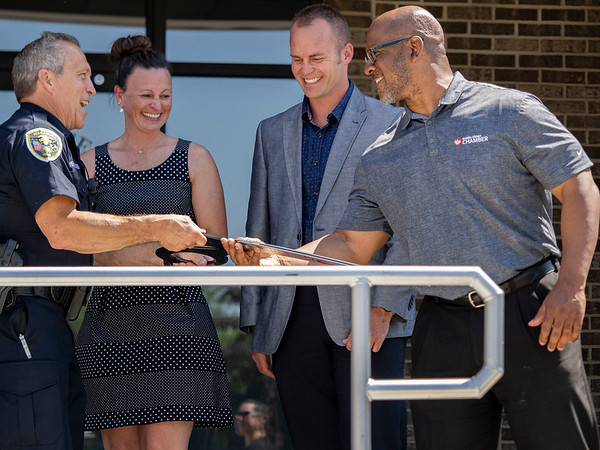 Walkarusa Town Marshal Tim Hershberger, left, and Greater Elkhart Chamber of Commerce President and CEO Levon Johnson exchange the ceremonial scissors Thursday afternoon at the Wakarusa Police Station during the Ribbon Cutting Ceremony at 102 Spring Street in Wakarusa.