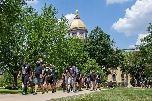 Notre Dame defensive lineman Daelin Hayes and Head Coach Brian Kelly lead the Juneteenth celebration in front of The Golden Dome Friday afternoon during Notre Dame's celebration of Juneteenth with peaceful prayer and walk.