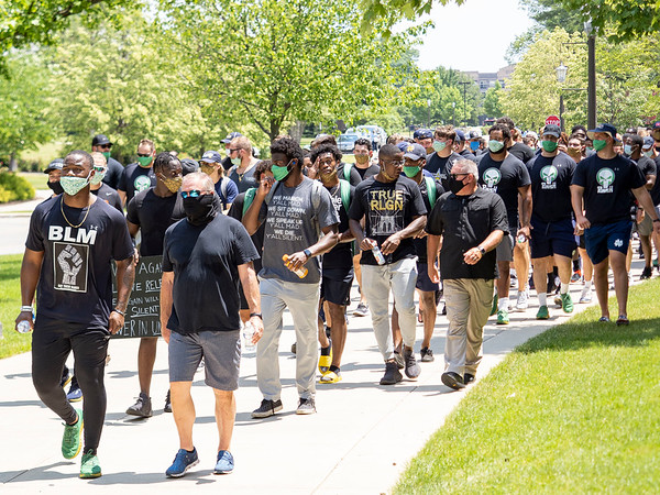 Notre Dame defensive lineman Daelin Hayes, left, and Head Coach Brian Kelly speak with each other and lead the Juneteenth celebration walk around Notre Dame Campus Friday afternoon during Notre Dame's celebration of Juneteenth with peaceful prayer and walk.