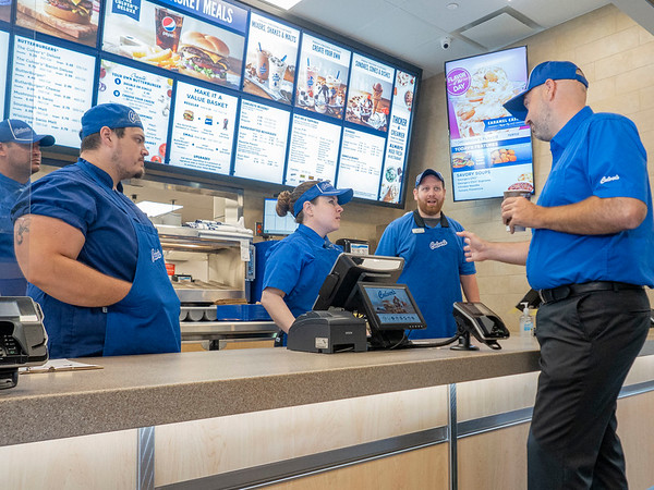 Culver's franchise co-owner Keith Remington talks with his staff Monday morning after the ribbon cutting ceremony at the new Culver's on Elkhart Road in Goshen.