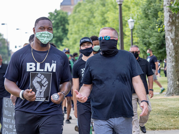 Notre Dame defensive lineman Daelin Hayes, left, and Head Coach Brian Kelly interact with each other an lead the Juneteenth celebration walk around Notre Dame Campus Friday afternoon during Notre Dame's celebration of Juneteenth with peaceful prayer and walk.