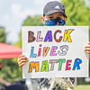 "Jackson Sumrack, 10, of Elkhart, holds up a ""Black Lives Matter"" sign at the at the Irish Green on Notre Dame Campus Friday afternoon during Notre Dame's celebration of Juneteenth with peaceful prayer and walk."