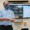 """SonSet Solutions President and CEO David Russell showcases the """"Coolest Thing Made in Elkhart County Award"""" Wednesday afternoon at SonSet Solutions in Elkhart for the development of the SonSetLink Water Monitor."""