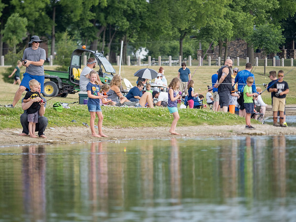 Fidler Pond's Fantastic Fishing Derby participants cast their lines into Fidler Pond Saturday morning.