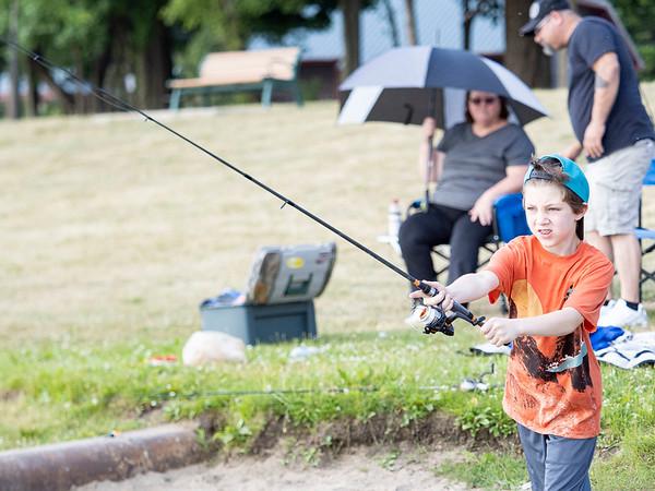 Christopher Karr, 9, of Ligonier, casts his line into Fidler Pond Saturday morning.
