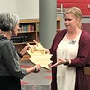 John Kline | The Goshen News<br /> Goshen Community Schools Superintendent Diane Woodworth, who is set to retire June 30, left, receives a ceremonial Key to the City from Goshen City Council member Megan Eichorn, D-District 4, on behalf of Goshen Mayor Jeremy Stutsman during a meeting of the Goshen school board Monday evening.