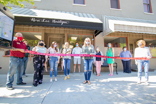 Rose Lee Boutique owner Rochelle Rock cuts the Goshen Chamber of Commerce ribbon Friday morning during the ribbon cutting ceremony at Rose Lee Boutique on 114 E. Washington St., Goshen. The boutique will be having an official grand opening Saturday, June 13.