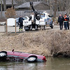 Thompson Towing tow truck driver drags a Chevrolet Trailblazer driven by Larry Stump from the millrace Wednesday morning. The millrace is located North of the Goshen Dam Pond.