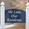 """A Roxbury Park sign stating """"We Love Our Residents"""" is posted at the park entrance of West Clinton Street and Remington Lane in Goshen. The park is located at 403 Post Road and is owned by parent company Sun Communities Inc."""