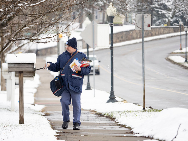 United States Postal Service mailman delivers mail along his route along State Road 15 Monday morning.