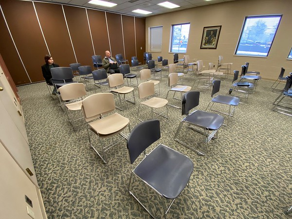 Roger Schneider | The Goshen News<br /> Social distancing was being practiced Monday morning at the Elkhart County commissioners meeting. Chairs in the meeting room were stacked to create separation space for those attending.