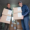 Grace Community Church Pastor Jim Brown, left, and Mike Silliman showcase a few cases of N95 masks they are donating to the Elkhart County Emergency Management Team Thursday afternoon. In total Grace Community Church donated over 30,000 N95 masks and bottles of hand sanitizer.