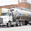 A Miller Poultry tractor trailer drives along Main Street Wednesday morning in Goshen.