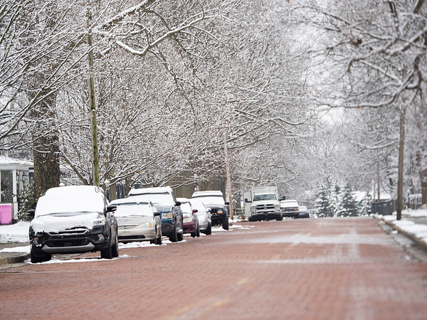 A light snow system coated the midwest Sunday evening with one to two inches of snow. This is view of Sixth Street near the intersection of Sixth Street and East Purl Street Monday morning.