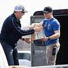 Mike Silliman, left, and Elkhart City Police Patrolman Bryce Moore, load N95 masks Grace Community Church isa donating to the Elkhart County Emergency Management Team Thursday afternoon. In total Grace Community Church donated over 30,000 N95 masks and bottles of hand sanitizer.