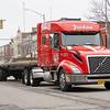 A Jordan Carriers tractor trailer drives along Main Street Wednesday morning in Goshen.