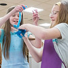 Anna Fussner, 11, left, and Isabelle Hilty, 10, both of Goshen, test the consistency of their slime during the Evil Genius Sessions: Ooey Gooey Slime Science Monday at the Goshen Public Library.