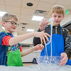 Magnus Eberly, 7, left, and Jude Eberly, 11, both of Goshen, test the consistency of their slime during the Evil Genius Sessions: Ooey Gooey Slime Science Monday at the Goshen Public Library.